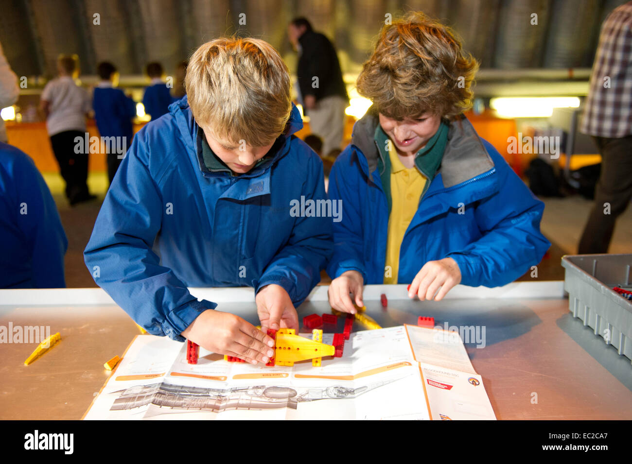 Children build a Lego world speed record attempt racing car - Stock Image
