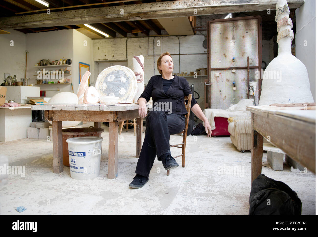 Sandie Brown sculptor artist at home in her studio in Appledore Devon - Stock Image