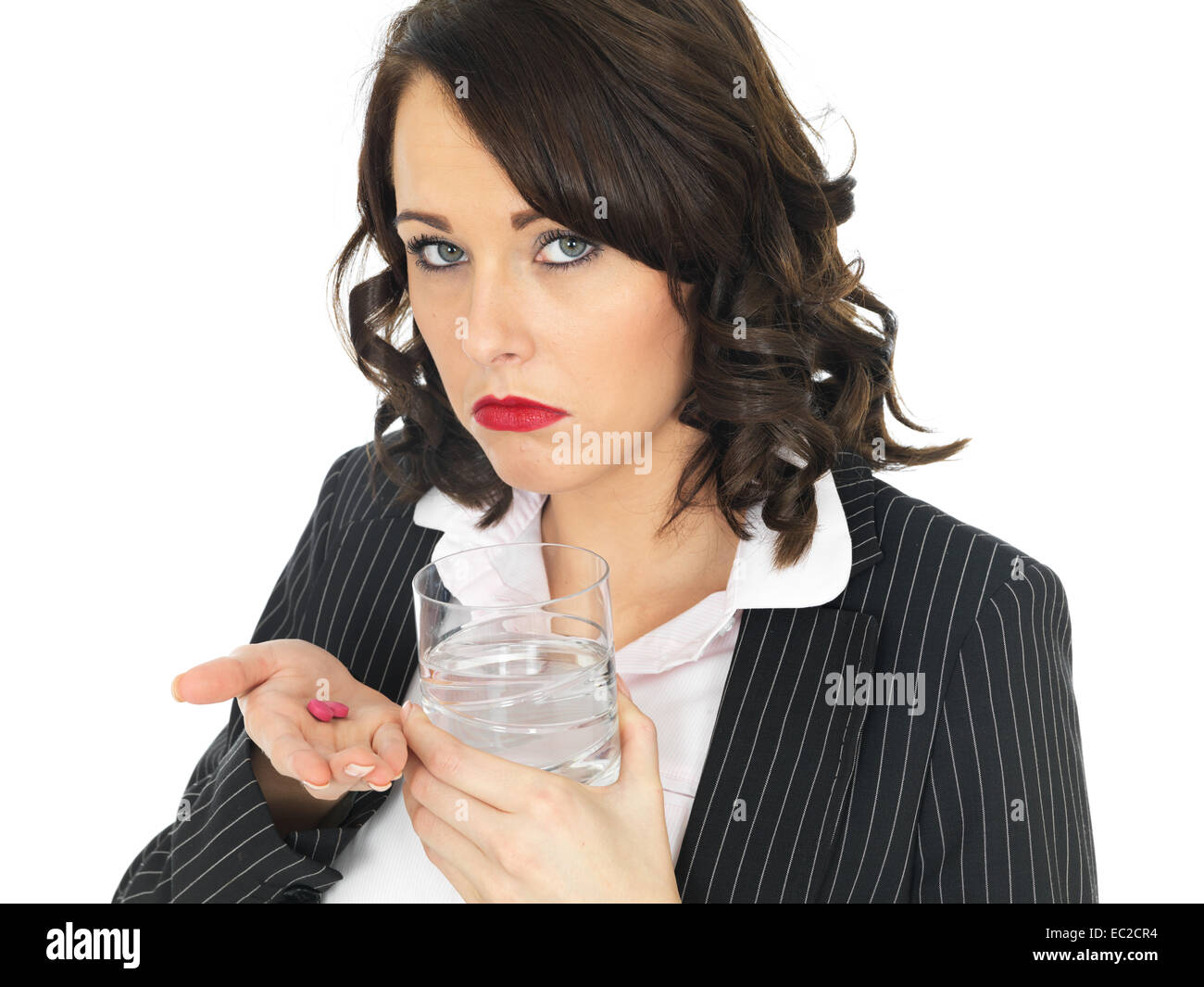 Unwell Business Woman Taking Tablets - Stock Image