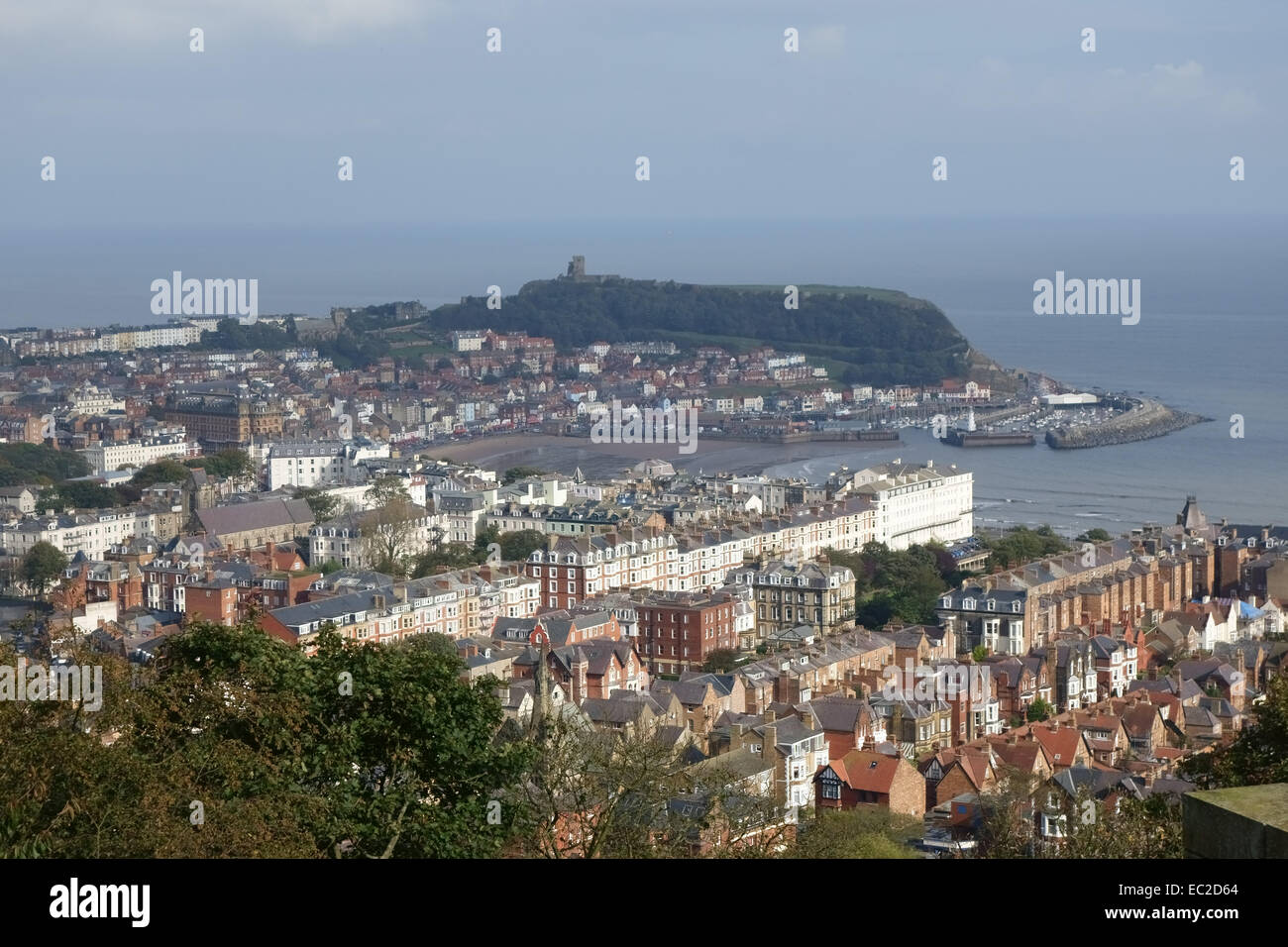 Overlooking Scarborough town from Oliver's Mount with the bay and Scarough Castle beyound on a fine autumn day - Stock Image