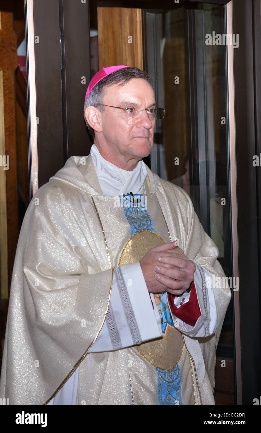 Salford, Greater Manchester, UK  8th December 2014 Bishop John Arnold  waits inside the main door of the Cathedral - Stock Image