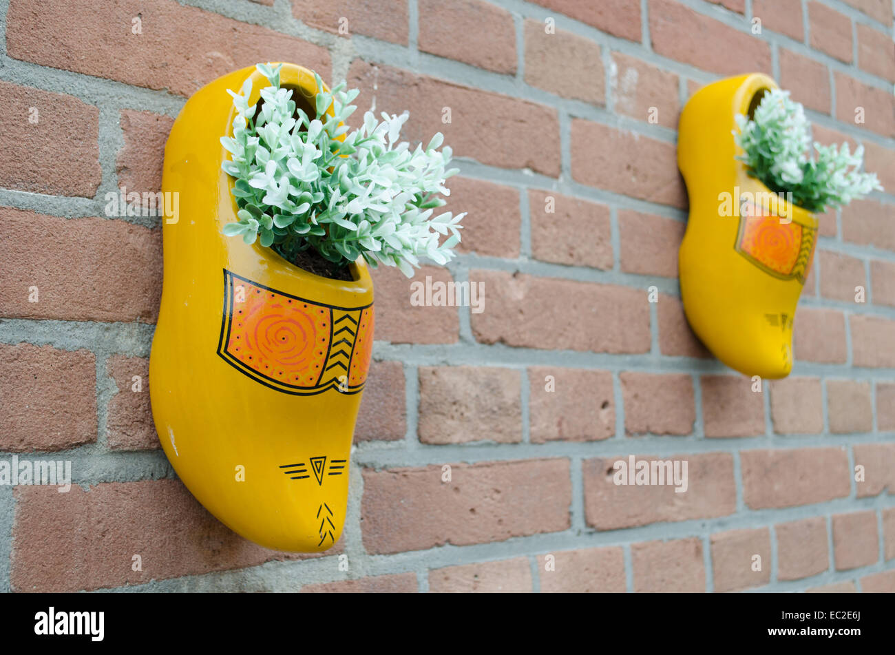 Dutch wooden shoes hanging on the wall - Stock Image