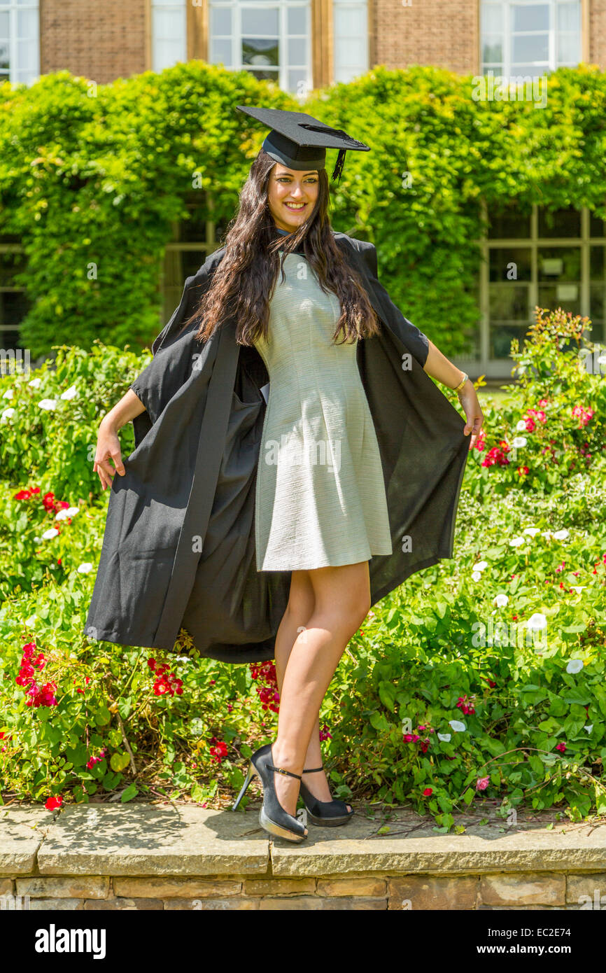 A Female University Student posing in her Graduation Cap and Gown ...