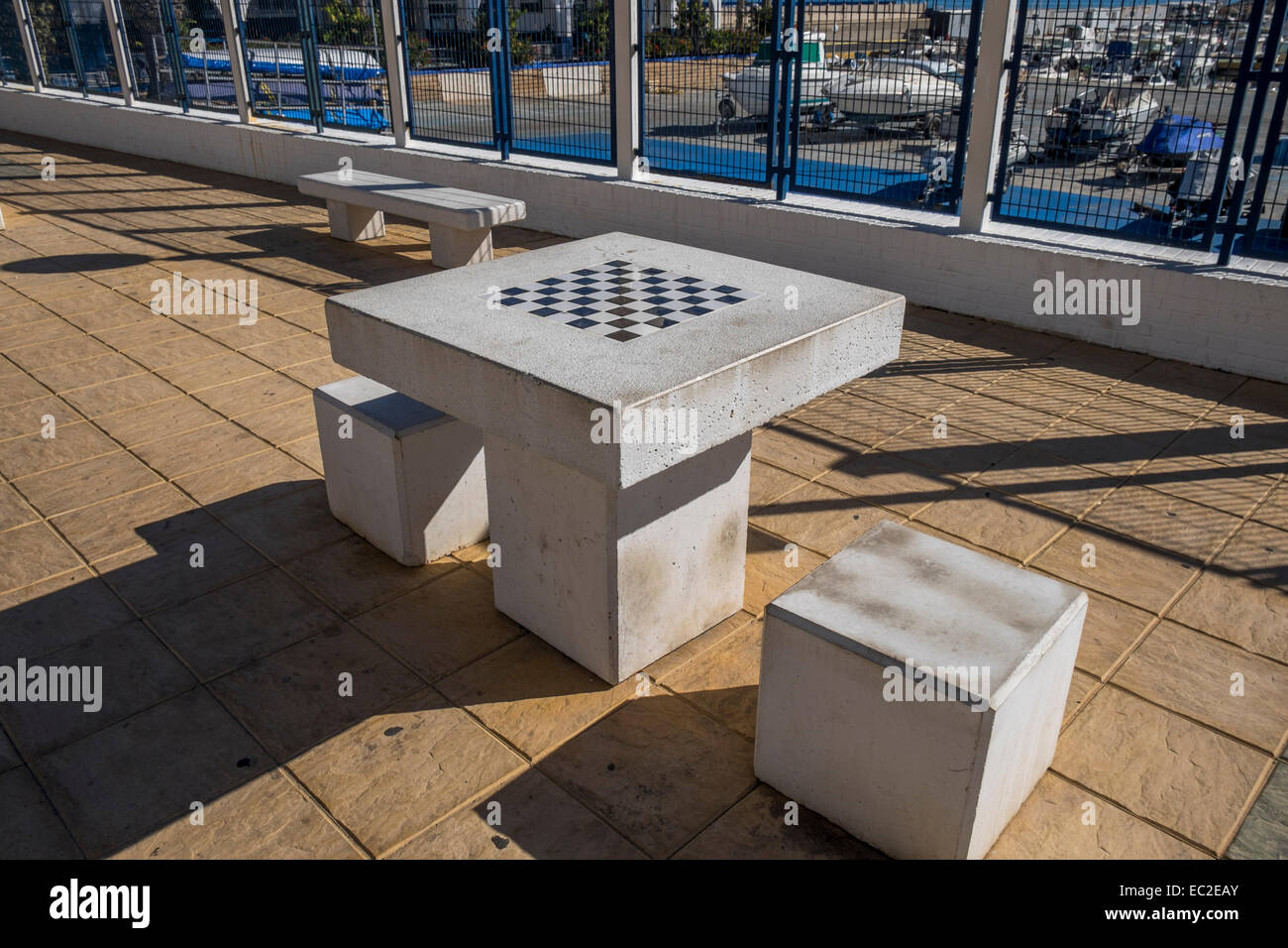 An Outside Stone Chess Table With Stone Seats For Two People   Stock Image