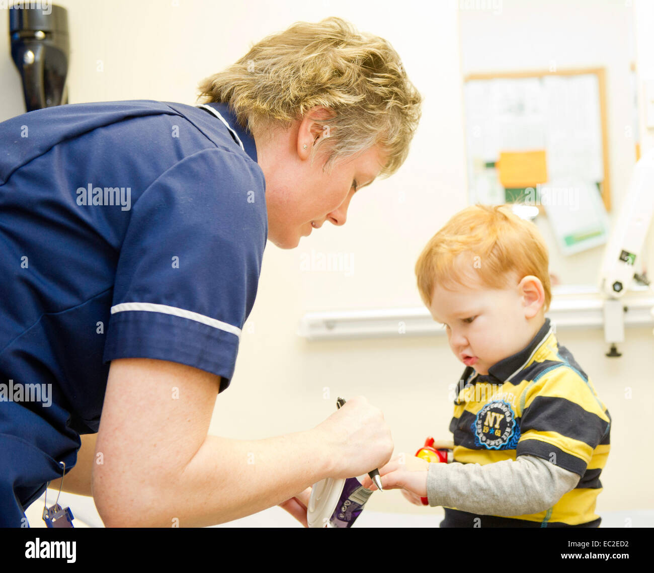 A little boy at the doctors surgery having a check up - Stock Image
