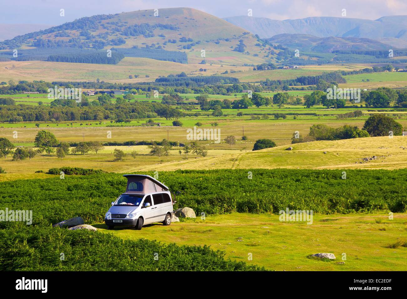 Camper Van parked on moor The Lake District National Park, Cumbria, England, UK. - Stock Image