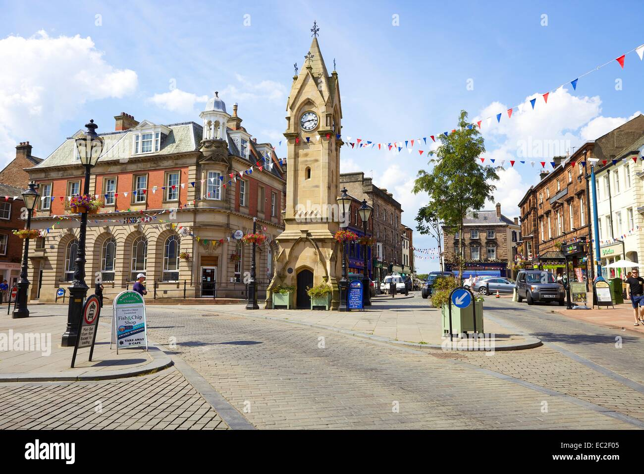 Town clock in the paved Market Square, King Street in Penrith town centre, Cumbria, England United Kingdom. - Stock Image