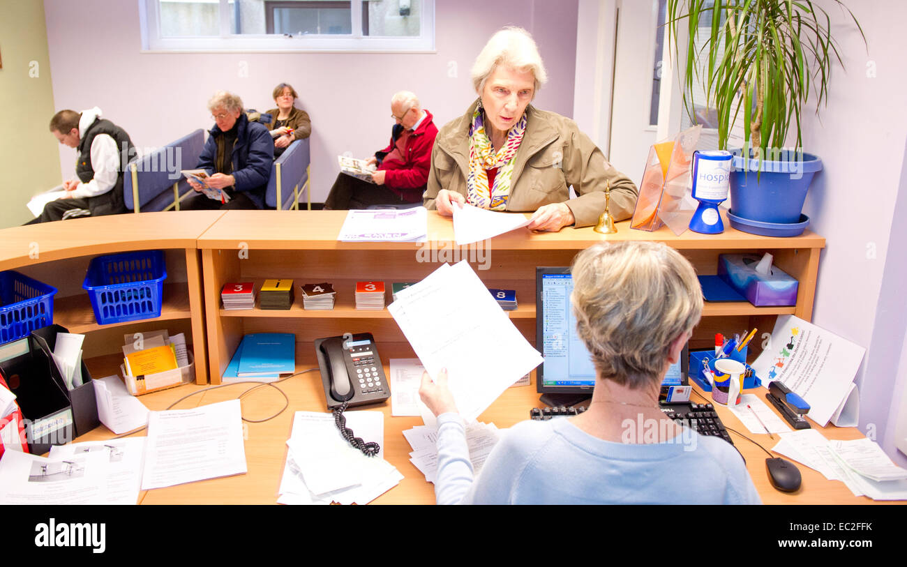 An NHS waiting room and reception desk - Stock Image