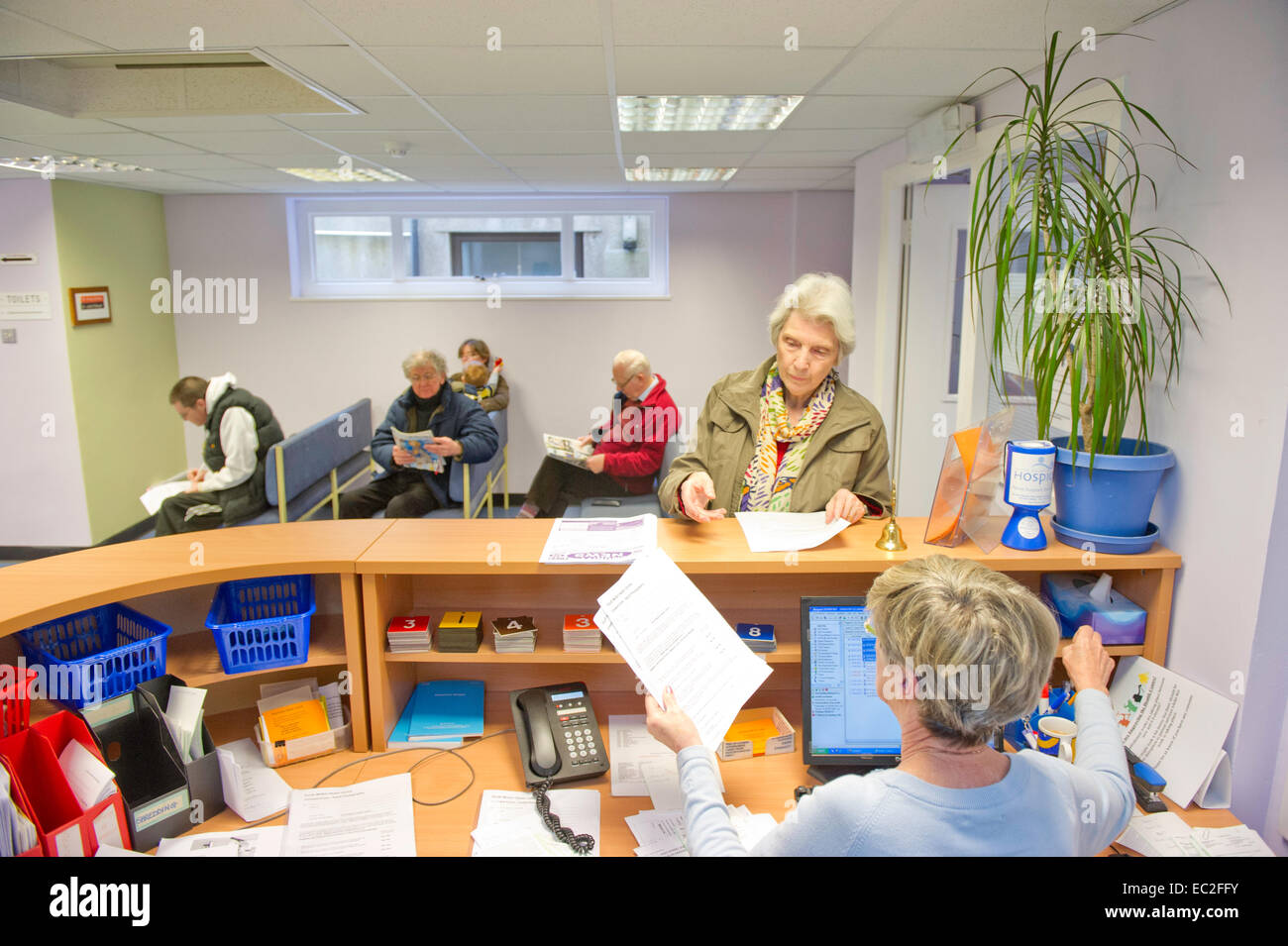 An NHS waiting room and reception desk Stock Photo