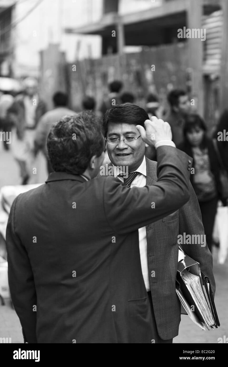 En In Suits Talking On The Comercio Pedestrian Street City Center La Paz