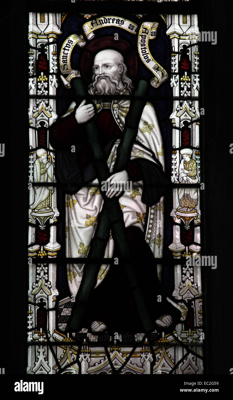A stained glass window by Herbert William Bryans depicting Saint Andrew, Letheringsett Church, Norfolk - Stock Image