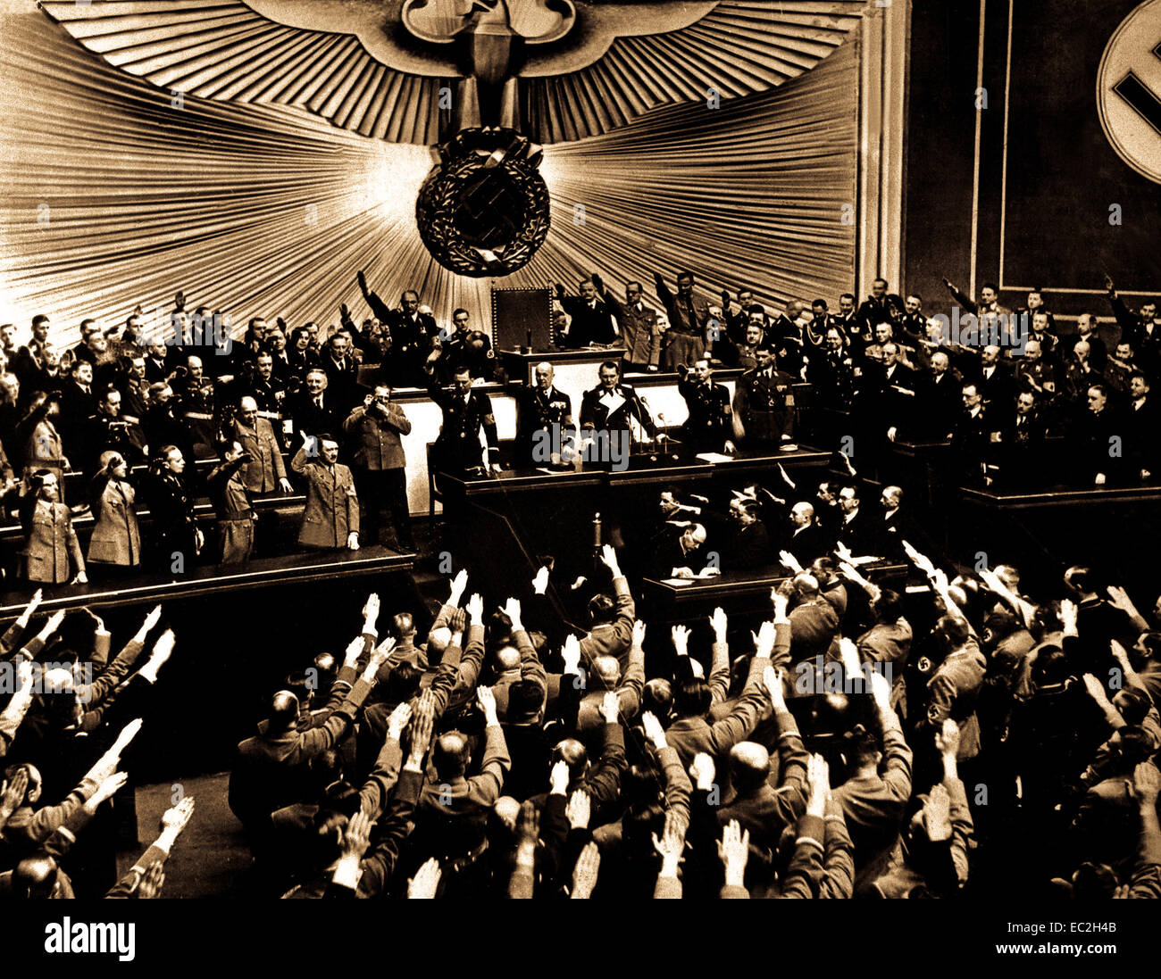 Hitler accepts the ovation of the Reichstag after announcing the 'peaceful' acquisition of Austria.  It - Stock Image