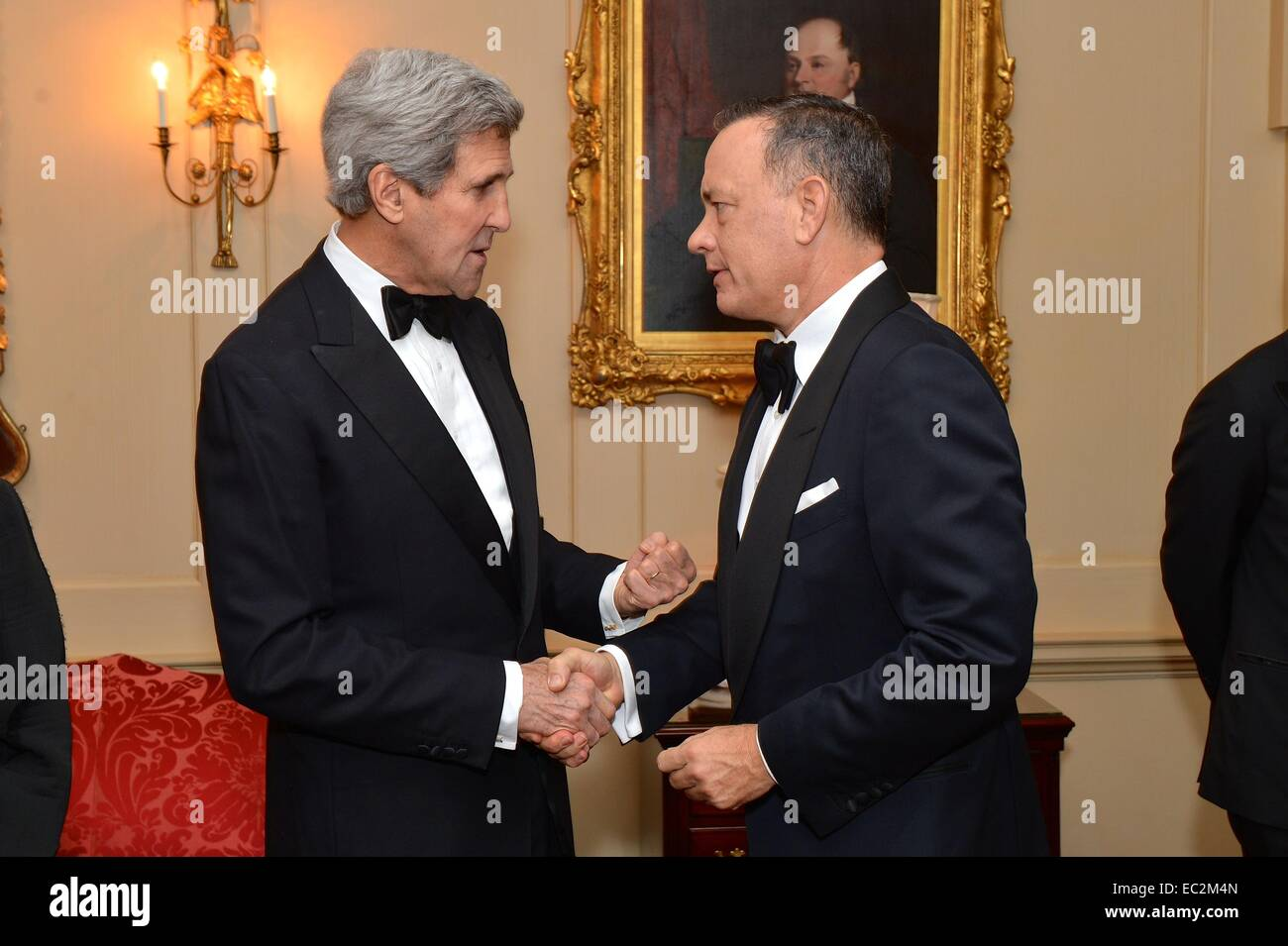 US Secretary of State John Kerry greets actor Tom Hanks before a dinner for the 2014 Kennedy Center Honorees at - Stock Image