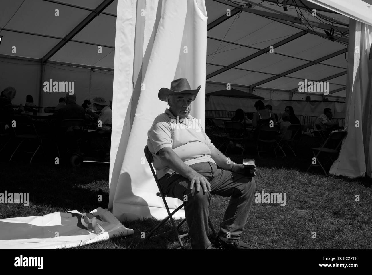 Man drinking beer / Corbridge Steam & Vintage Rally - Stock Image