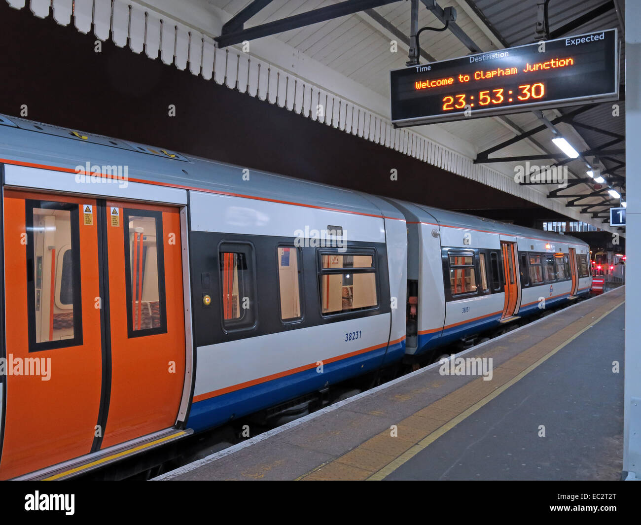 Welcome to Clapham Junction railway station at night, London's busiest, England, UK - Stock Image