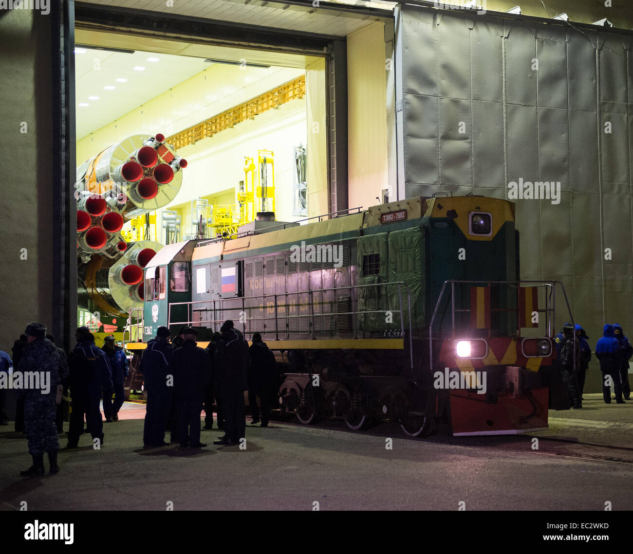 The Soyuz rocket is prepared to be rolled out by train to the launch pad on Friday, Nov. 21, 2014 at the Baikonur - Stock Image
