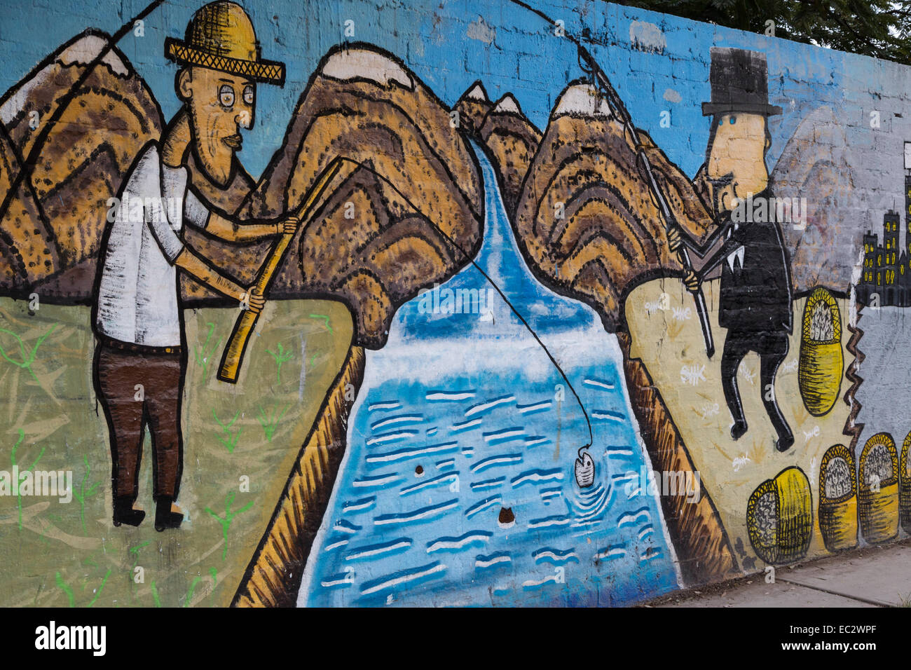 Urban art depicting two men fishing.  One stealing the catch of the other in the Spanish colonial city of Santiago - Stock Image