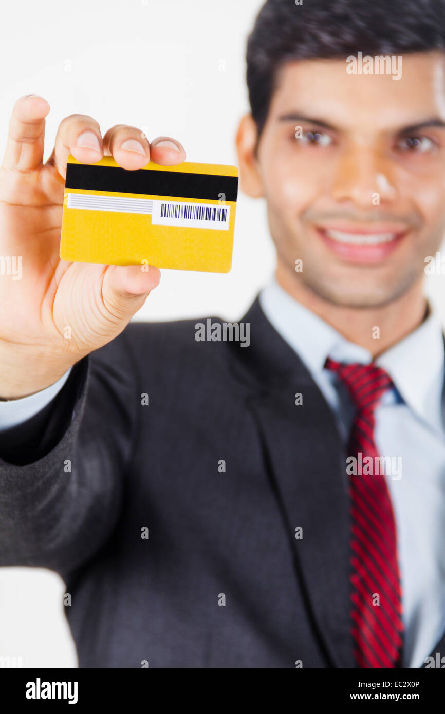 Indian business man showing credit card stock photo 76281654 alamy indian business man showing credit card reheart Images