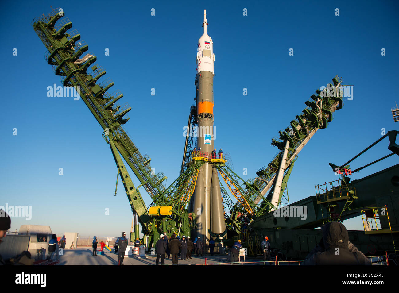 The gantry arms close around the Soyuz TMA-15M spacecraft to secure the rocket at the launch pad on Friday, Nov. - Stock Image