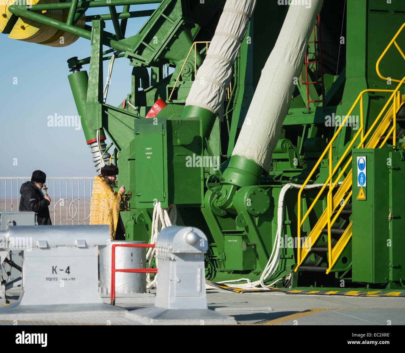 An Orthodox priest blesses the Soyuz rocket at the Baikonur Cosmodrome launch pad on Saturday Nov. 22, 2014, in - Stock Image