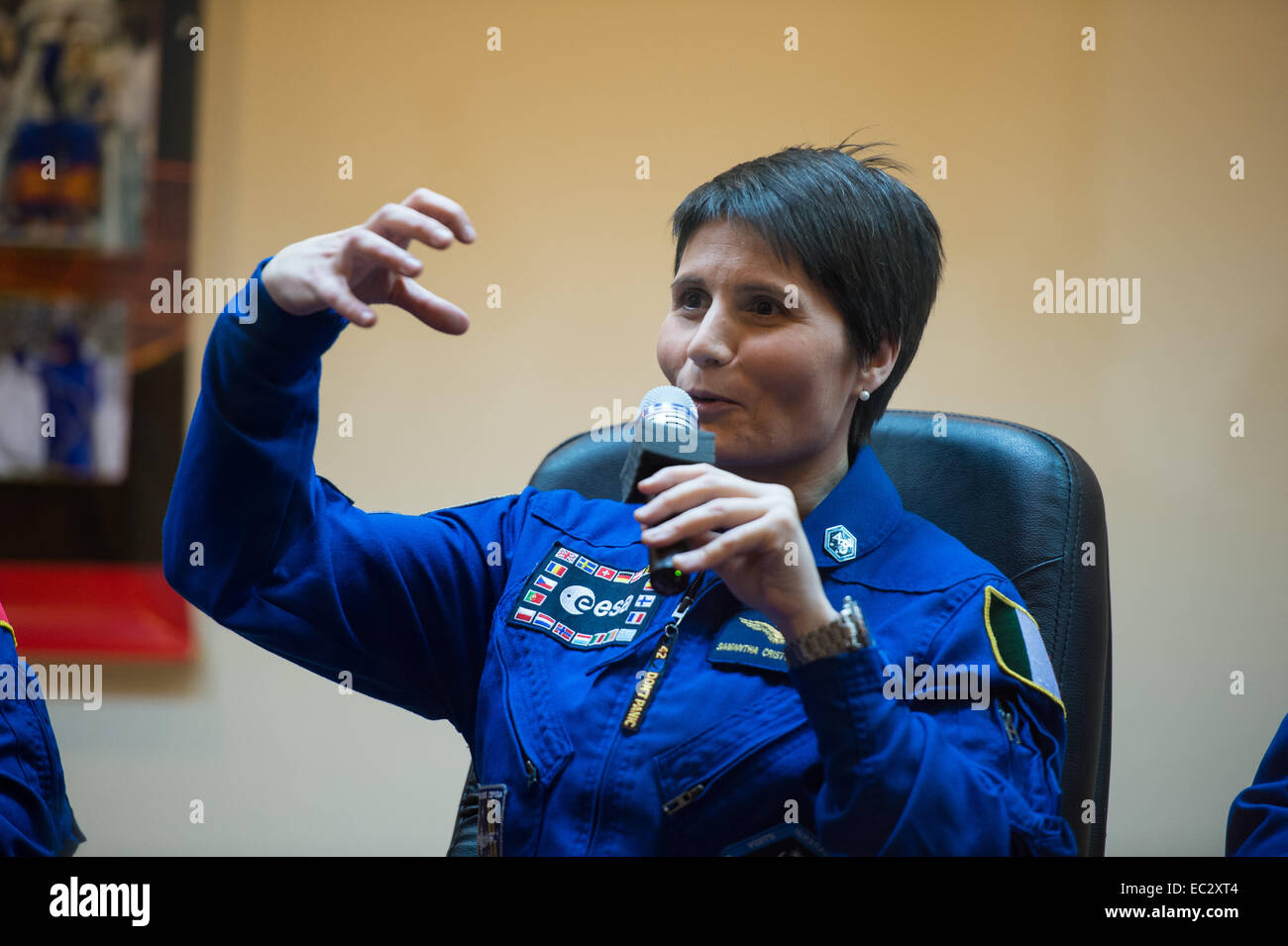 Expedition 42 Flight Engineer Samantha Cristoforetti of the European Space Agency (ESA) answers a question during - Stock Image