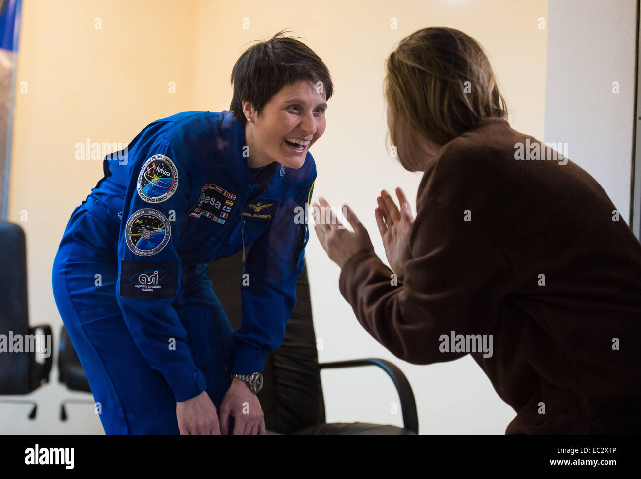 Flight Engineer Samantha Cristoforetti of the European Space Agency (ESA) speaks with friends and family through - Stock Image