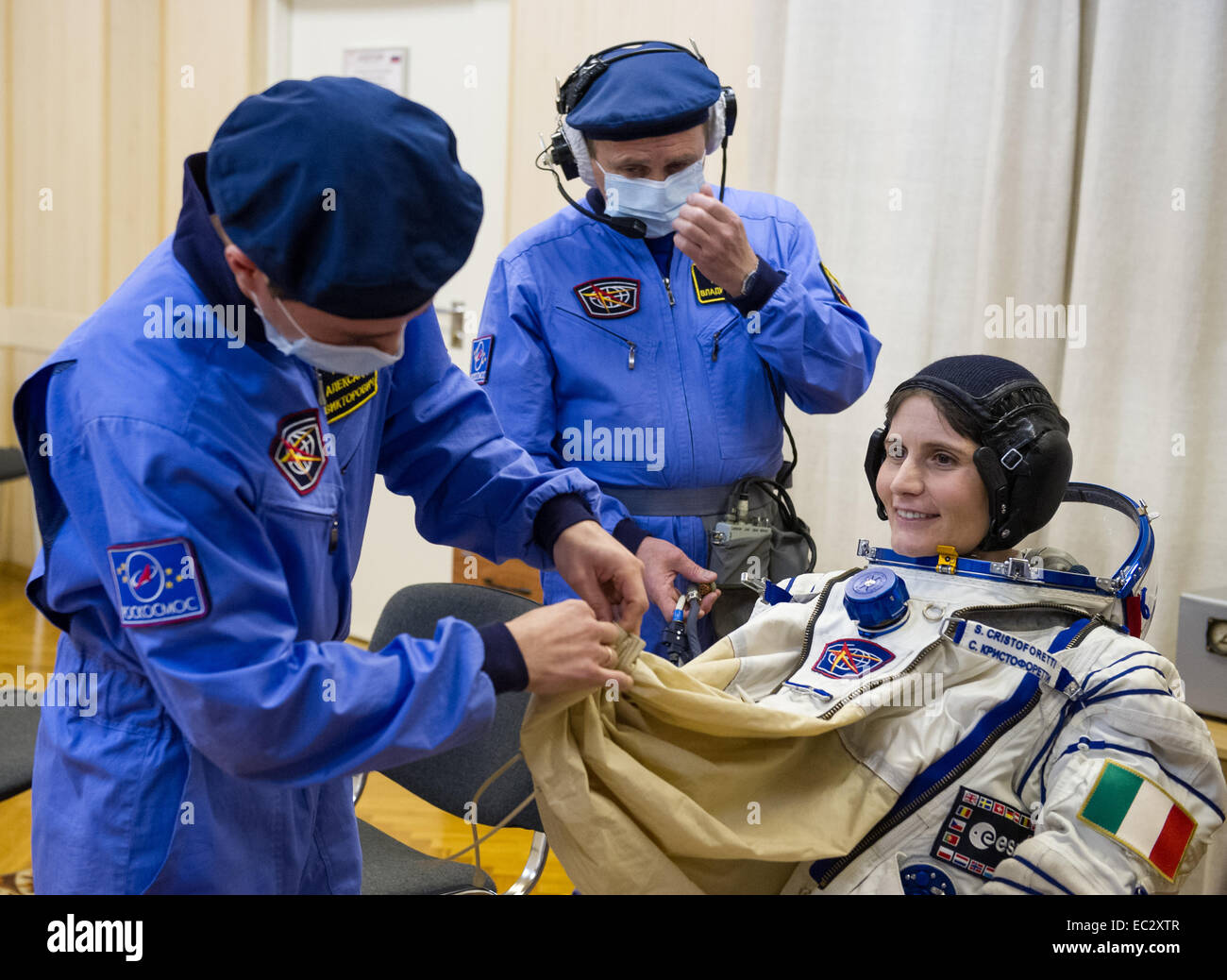Expedition 42 Flight Engineer Samantha Cristoforetti of the European Space Agency (ESA) is helped into her Russian - Stock Image