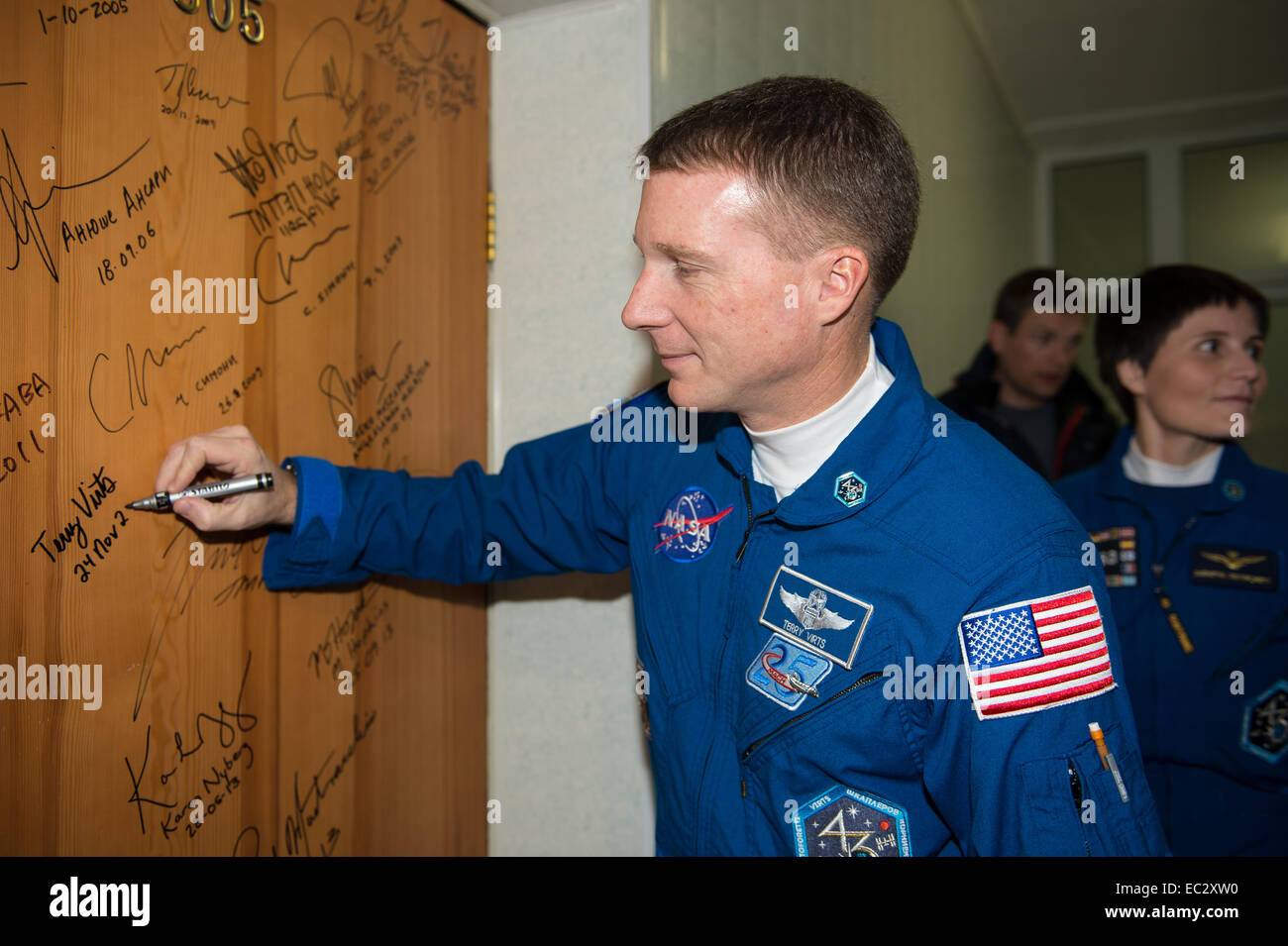 Expedition 42 Flight Engineer Terry Virts of NASA performs the traditional door signing at the Cosmonaut Hotel prior - Stock Image