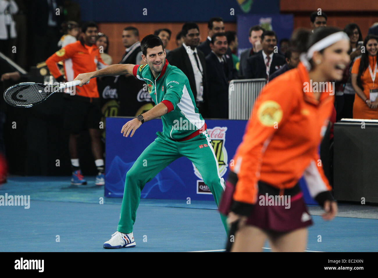 New Delhi, India. 8th Dec, 2014. Serbian tennis player Novak Djokovic (L) prepares to return a ball from Bollywood - Stock Image