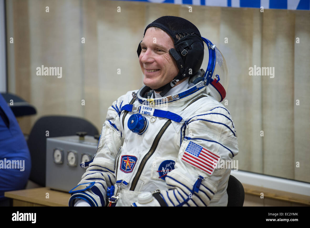 Expedition 42 Flight Engineer Terry Virts of NASA waits for a pressure check of his Sokol suit in Building 254 following - Stock Image