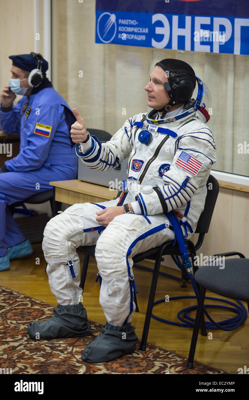 Expedition 42 Flight Engineer Terry Virts of NASA gives a thumbs up while waiting for a pressure check of his Sokol - Stock Image
