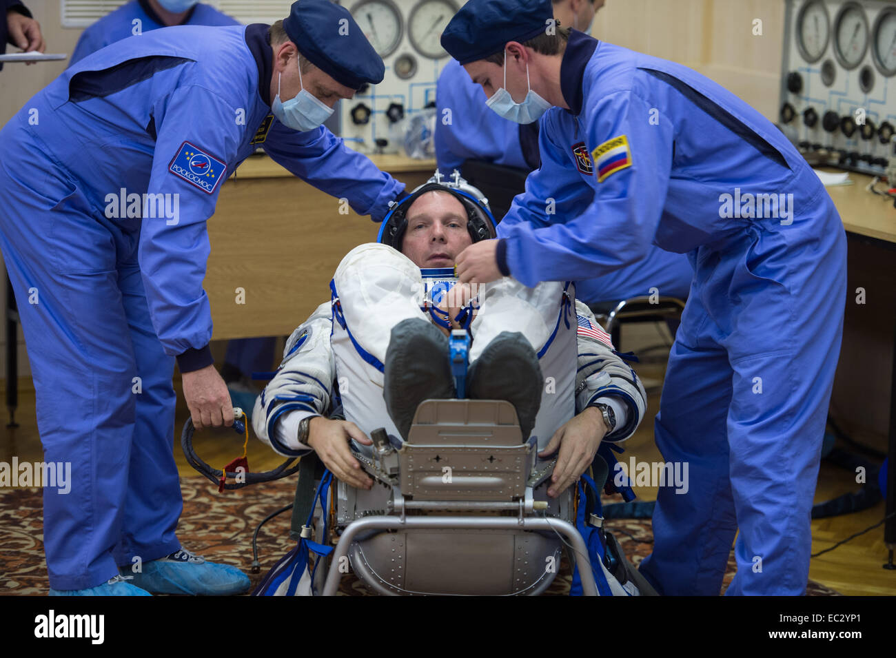 Expedition 42 Flight Engineer Terry Virts has his Russian Sokol suit pressure checked in preparation for his launch - Stock Image