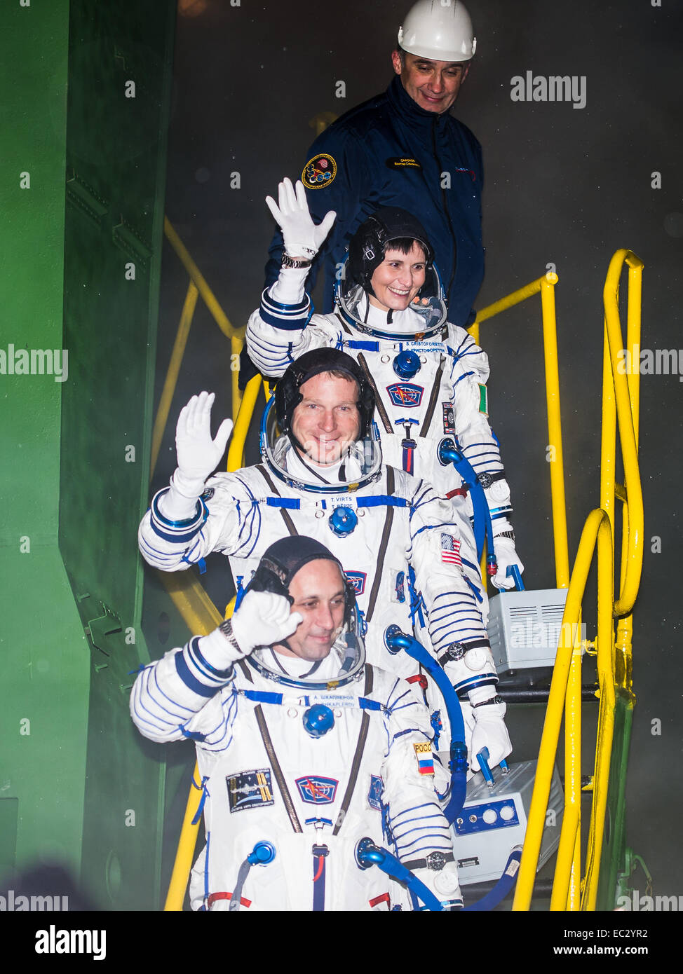 Expedition 42 Flight Engineer Samantha Cristoforetti, of the European Space Agency (ESA), top, Flight Engineer Terry - Stock Image