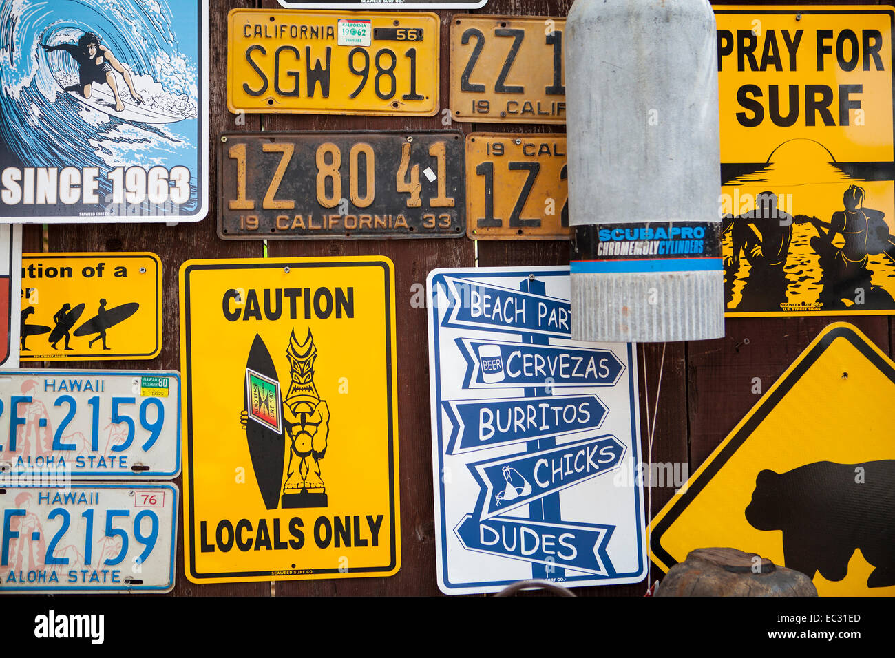 Surfing Related Signs And Vintage License Plates On A Wall Pismo Beach Central Coast California USA