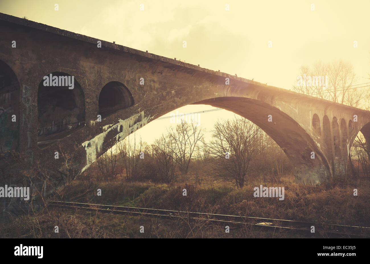 Retro vintage filtered picture of an arch bridge. - Stock Image