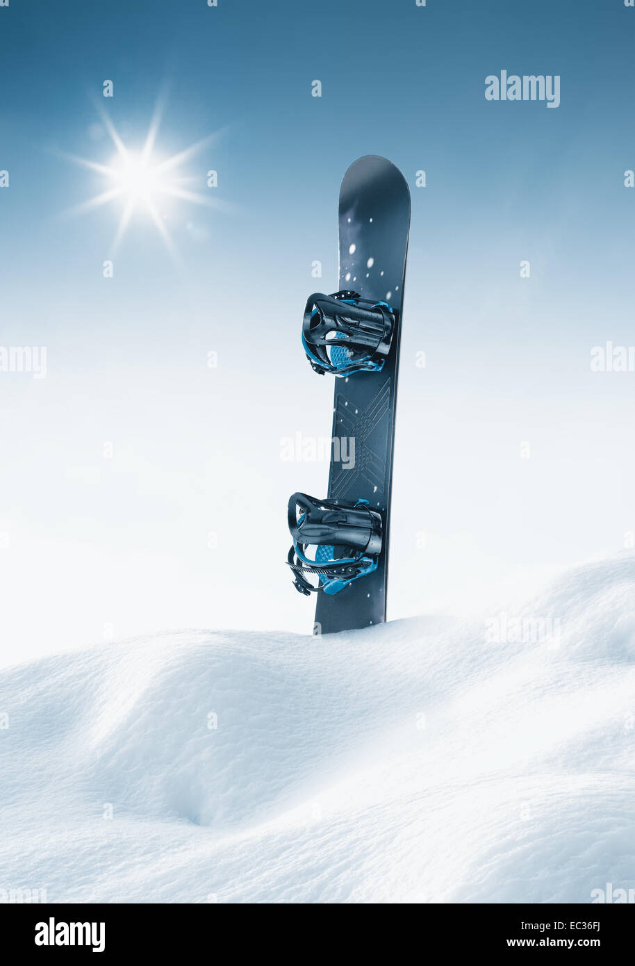 view of nice blue snowboard in winter environment - Stock Image