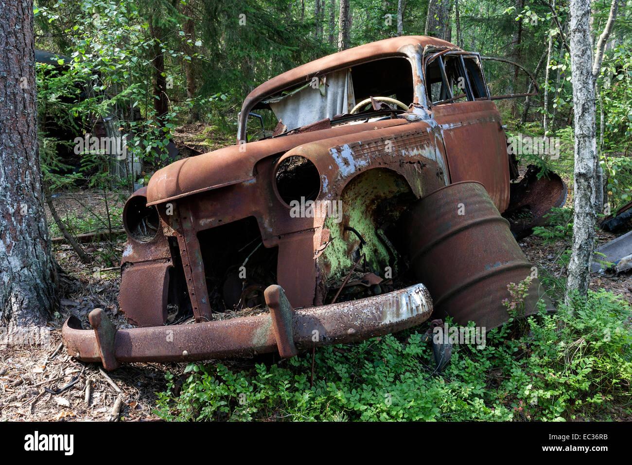 Junkyard in the forest, junk car, 40s, at Ryd, Småland, Sweden Stock ...