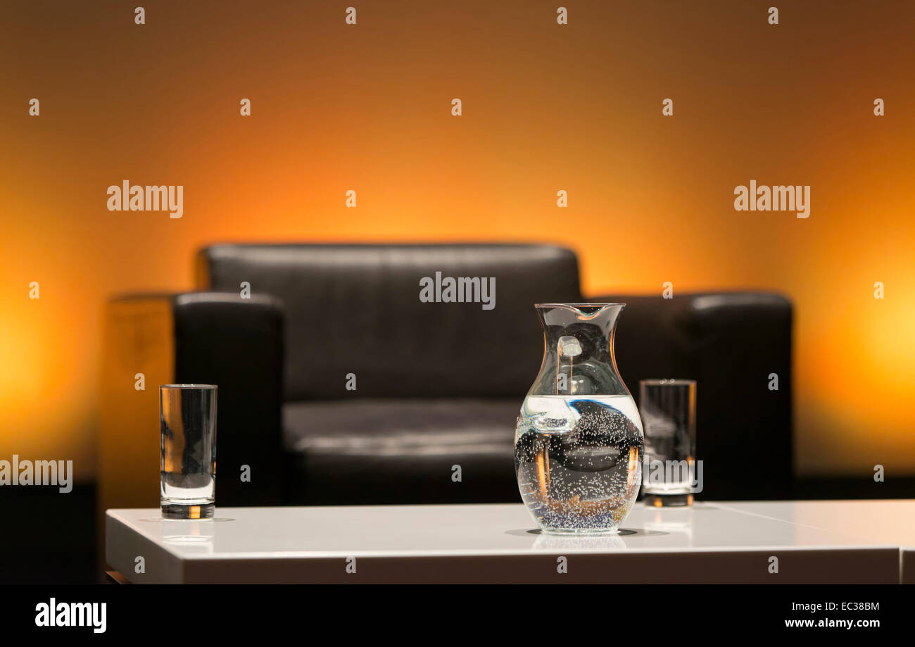 Glasses and carafe with water, panel discussion in Munich, Bavaria, Germany - Stock Image