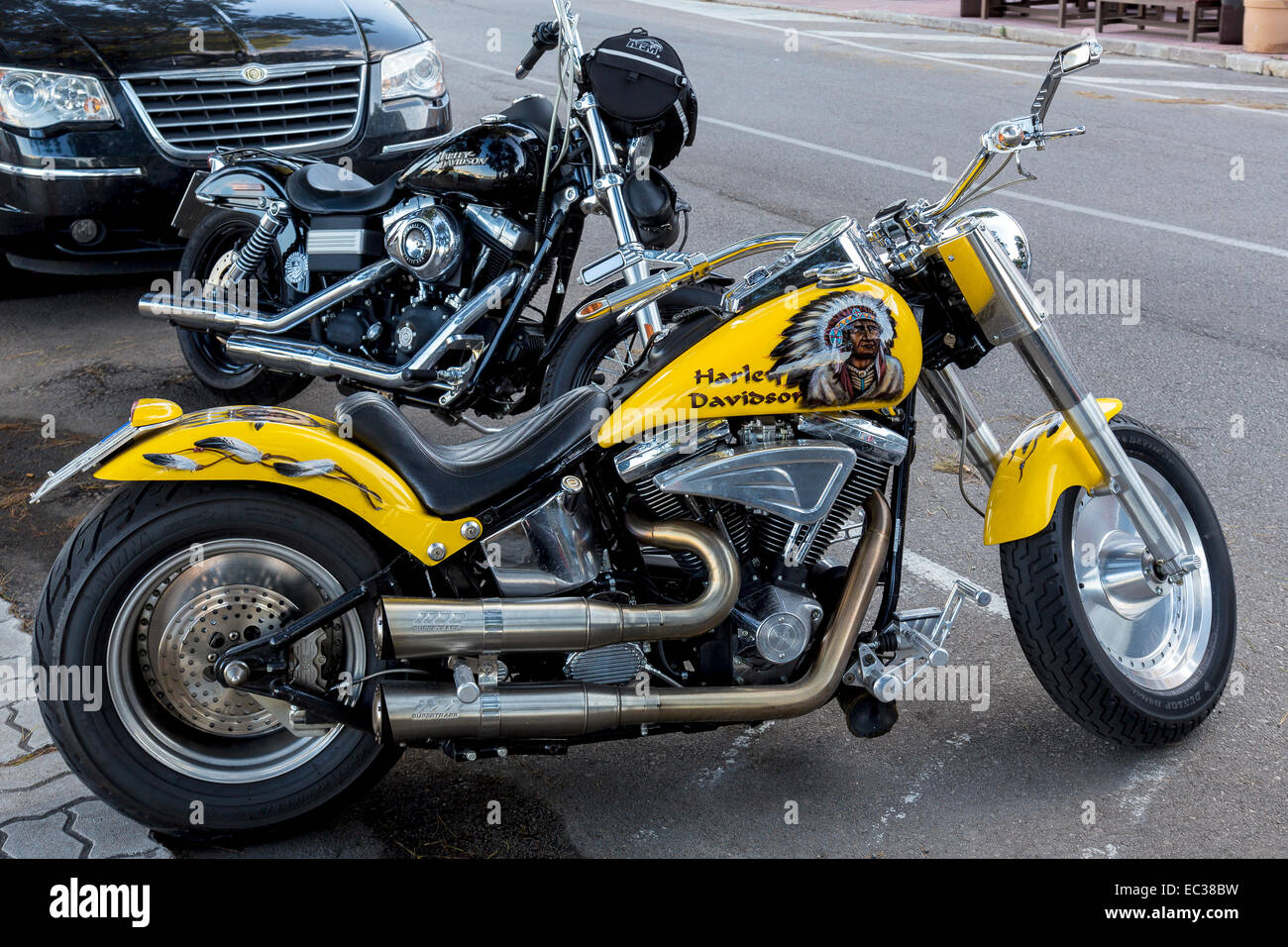 Two Harley Davidson parked on the roadside, Porto Colom, Majorca, Balearic Islands, Spain - Stock Image