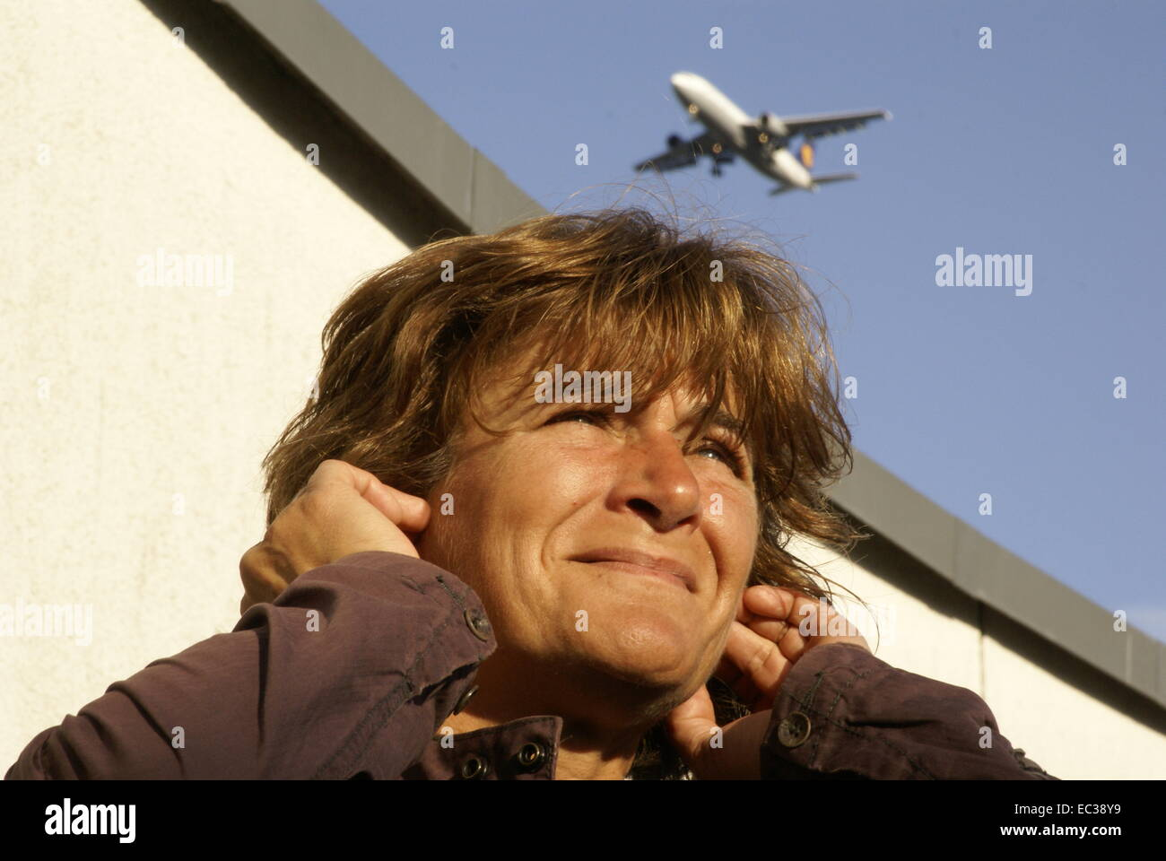 Disturbance by Aircraft Noise - Stock Image