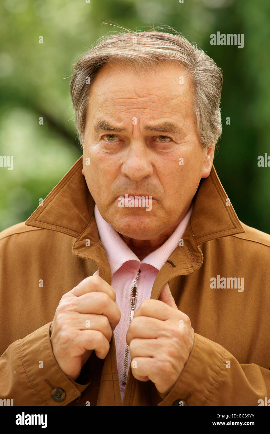 skeptical older man - Stock Image