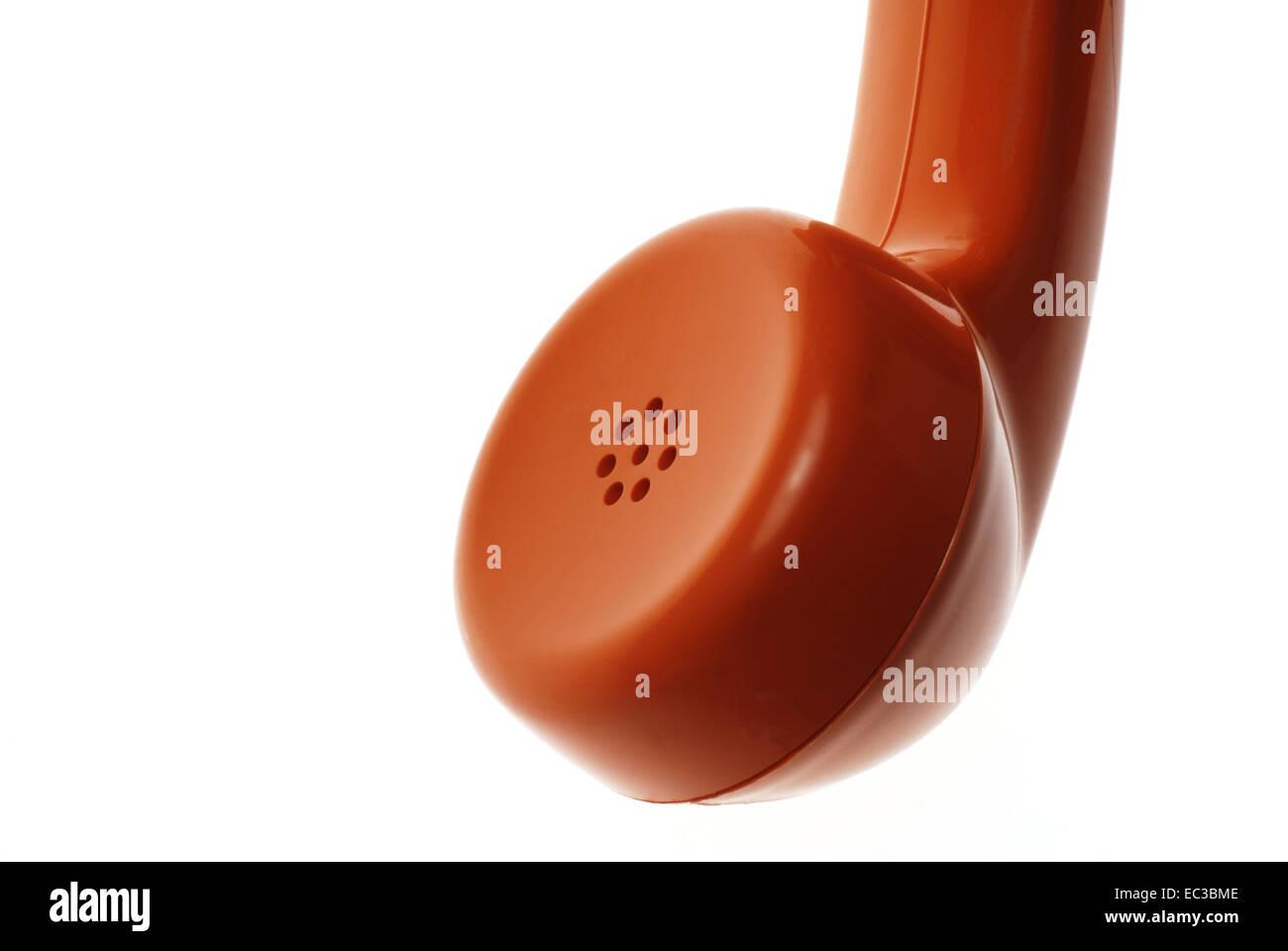 Isolated Old Orange Telephone Receiver - Stock Image