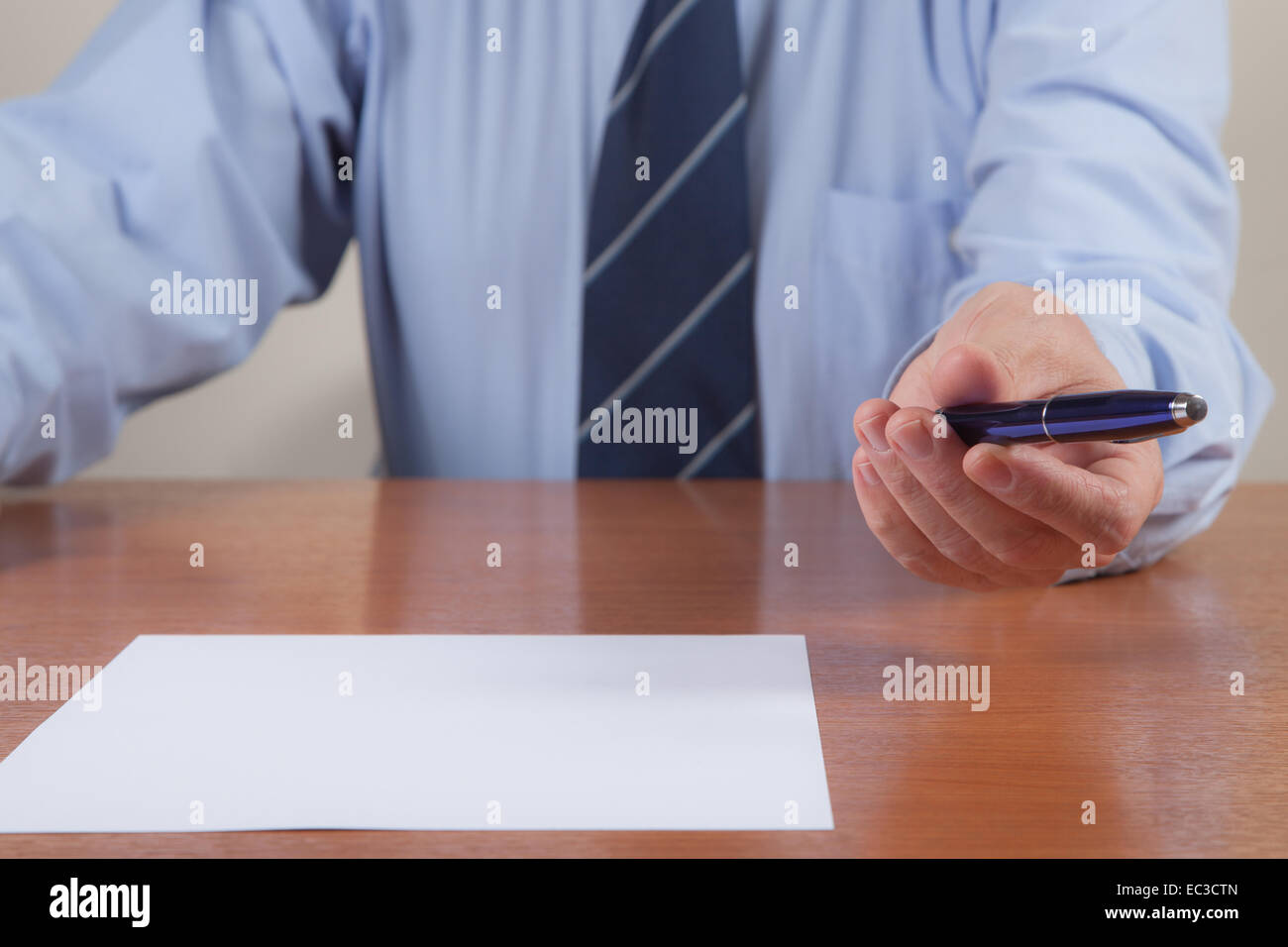 Men with pen and white sheet. - Stock Image