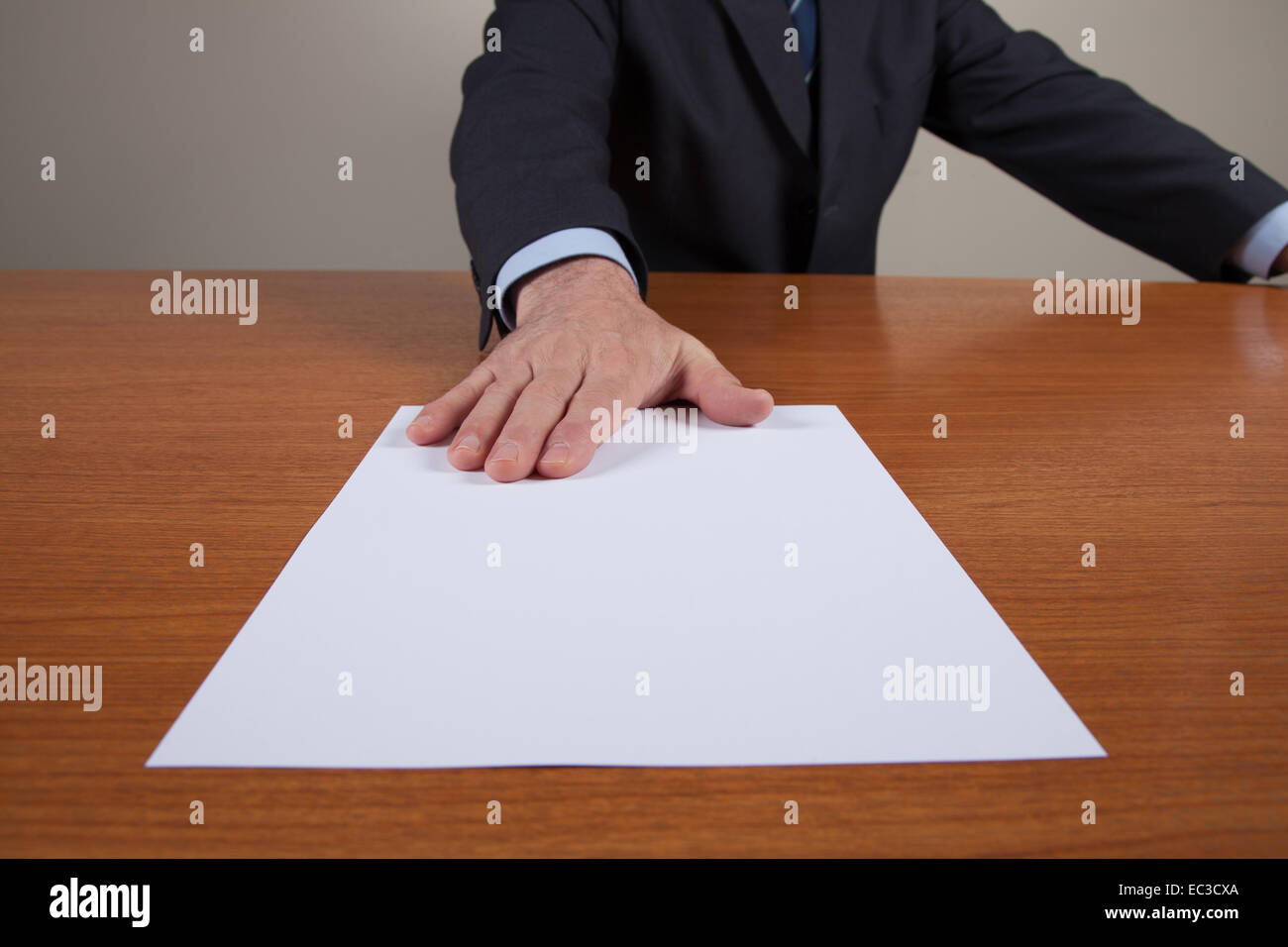 Men with one white sheet on the table. - Stock Image