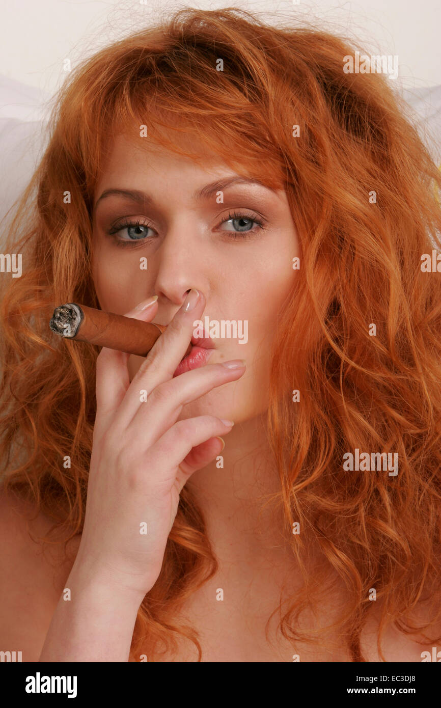Redheaded Woman with Cigar - Stock Image