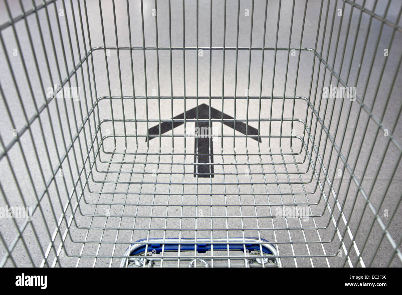 Shopping cart moving along the market trail. - Stock Image