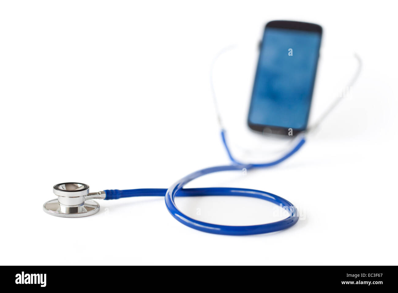 Stethoscope and mobile phone isolated on white background - Stock Image