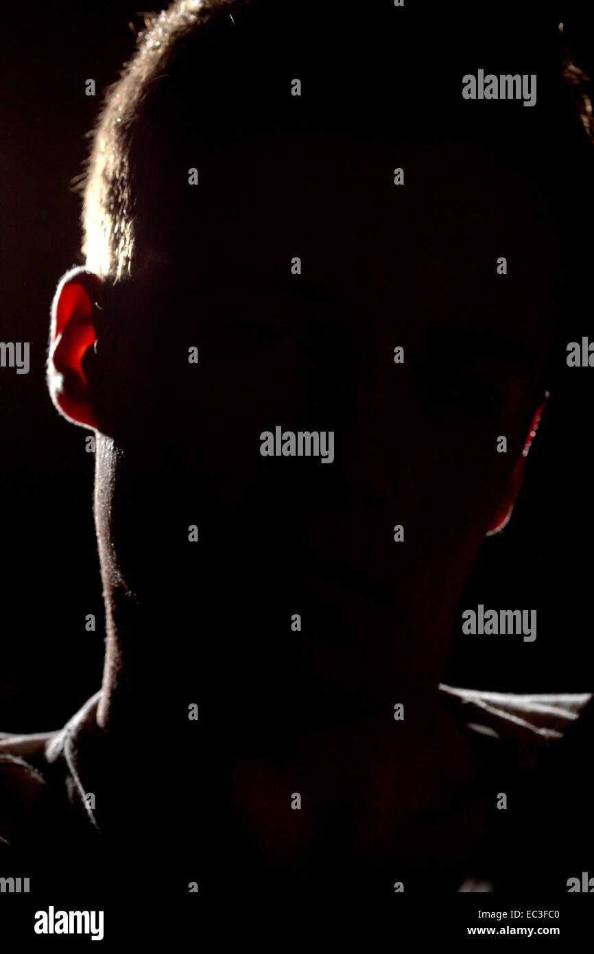 Youth, young person during interrogation or a person remain anonymous in an interview with a black face against - Stock Image
