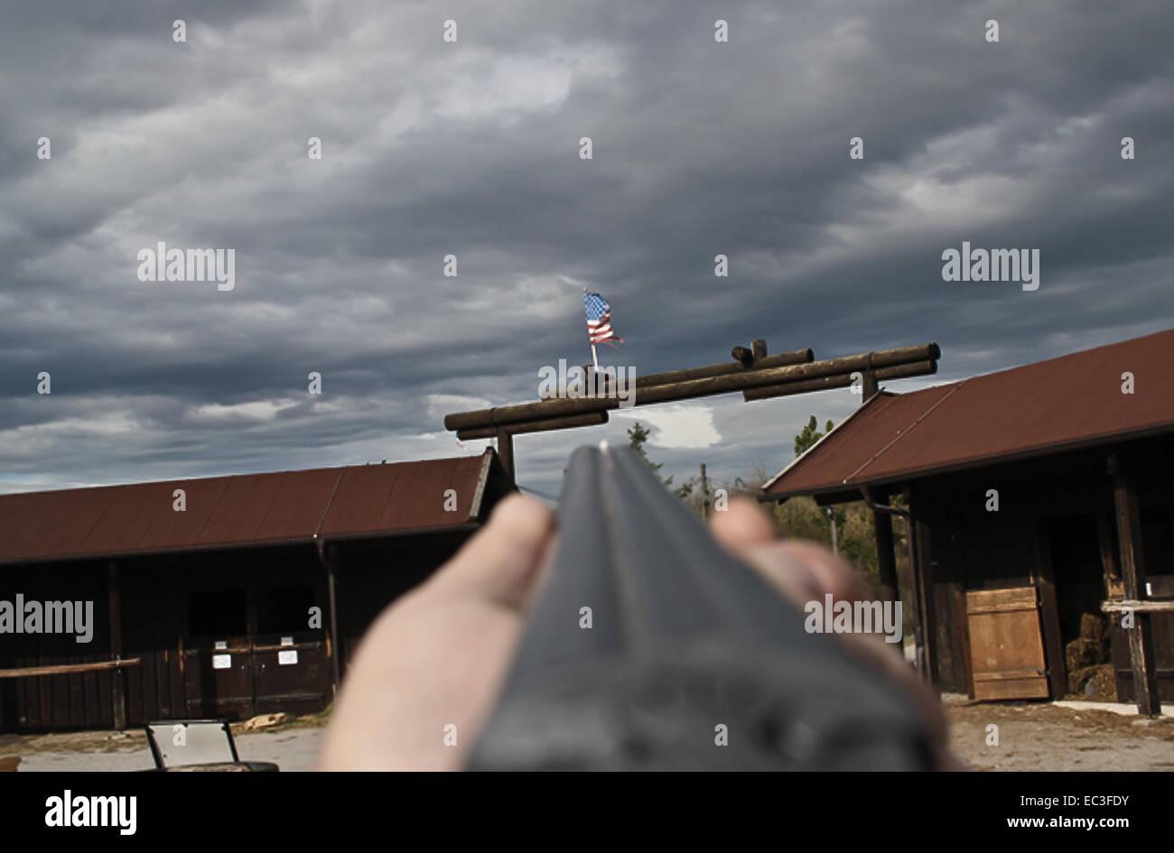 GUn shoots on USA flag - Stock Image