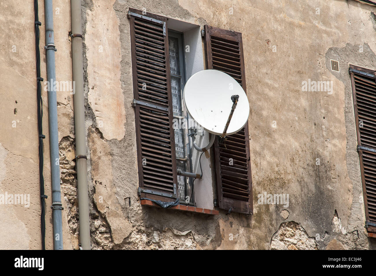 satilite receiver at an old house - Stock Image